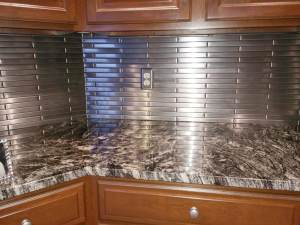 Stainless Steel Tile backsplash featured in a kitchen makeover
