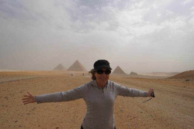 Thea battling the sandstorm at the Pyramids of Giza