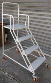 warehouse ladders attached to shelving