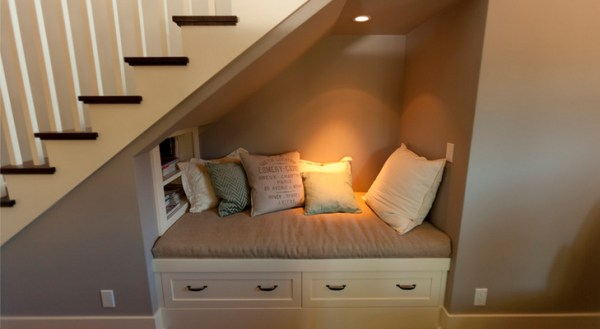 Armchair or small sofa under the stairs