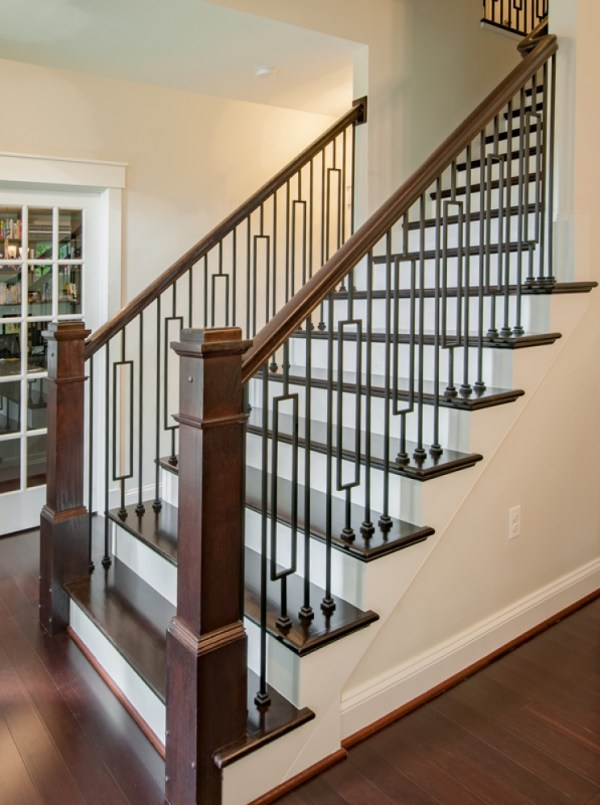 wooden staircase with iron balusters_25