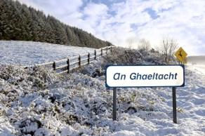 13450254 - an ghaeltacht sign in snow scene in irish speaking area of county kerry ireland