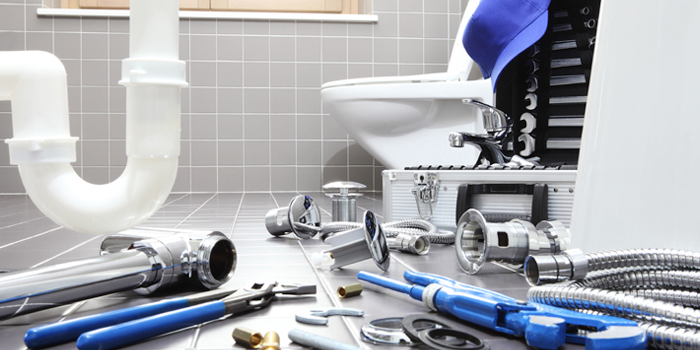 Services - Bathroom with plumbing tools strewn across the floor