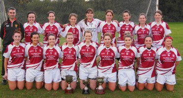 The St Colmcilles Ladies after winning the 2016 League Final - Pictured with the Oxford 7s trophy and the Glo-Herts League and Championship trophies