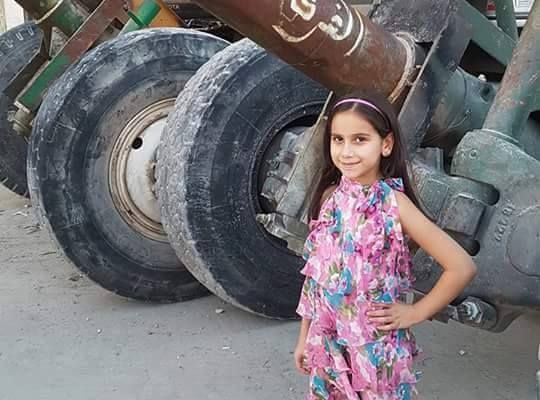 "Girl from Aleppo stands next to hell cannon the ""moderates"" used to attack her district."