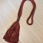 neckrope met gevlochten afwerking
