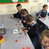 Pupils creating poppies