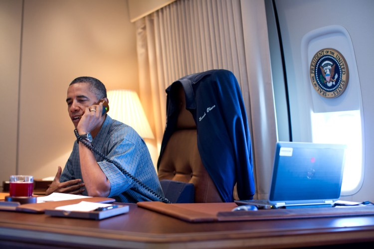President Barack Obama talks on the phone with NASA's Curiosity Mars rover team aboard Air Force One during a flight to Ouffutt Air Force Base in Nebraska, Aug. 13, 2012. (Official White House Photo by Pete Souza) This photograph is provided by THE WHITE HOUSE as a courtesy and may be printed by the subject(s) in the photograph for personal use only. The photograph may not be manipulated in any way and may not otherwise be reproduced, disseminated or broadcast, without the written permission of the White House Photo Office. This photograph may not be used in any commercial or political materials, advertisements, emails, products, promotions that in any way suggests approval or endorsement of the President, the First Family, or the White House.Ê