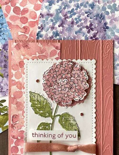 The coordinating Hydrangea Hill Designer Paper features the colors Rococo Rose, Gorgeous Grape, Highland Heather, Misty Moonlight, Mossy Meadow, and Whisper White