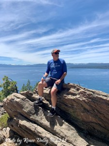 Don sitting on a rock overlooking Lake Tahoe