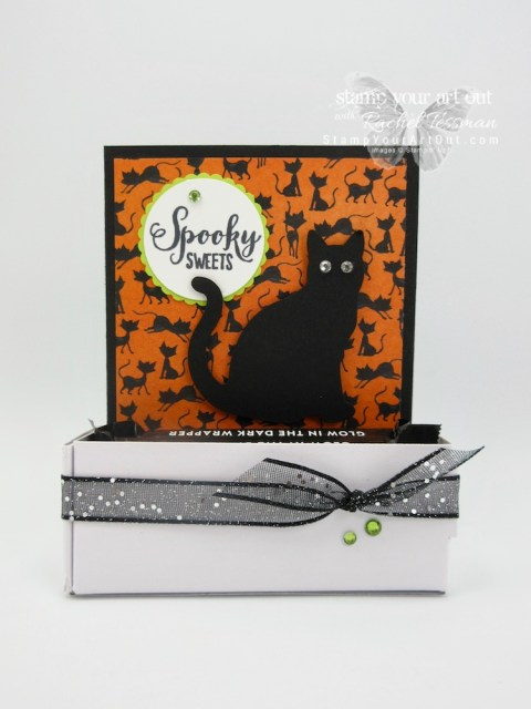 Click here to see how I made this fun Kit Kat treat box with coordinating card using Stampin' Up! products from the 2018-19 Annual Catalog (the Cat Punch, Rhinestones, & Mini Pizza Boxes) and the 2018 Holiday Catalog (Toil & Trouble Designer Paper, Spooky Sweets Stamp Set & Black Glittered Organdy Ribbon)…#stampyourartout #stampinup - Stampin' Up!® - Stamp Your Art Out! www.stampyourartout.com
