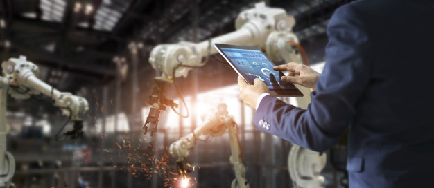 Manager industrial engineer using tablet check and control autom