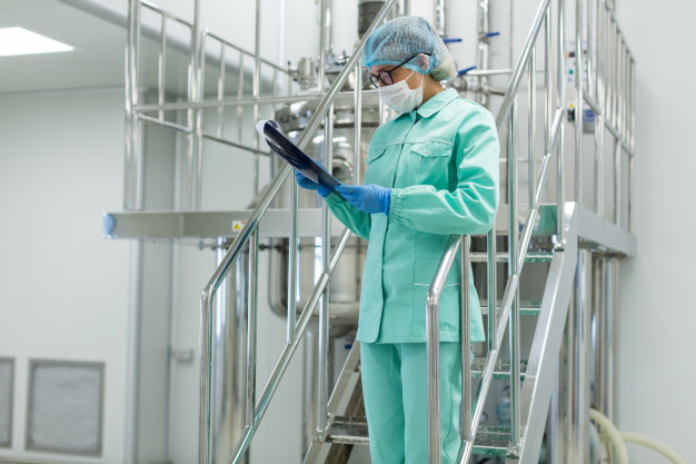 plant-picture-scientist-standing-steel-stairs-with-tablet_88135-1641