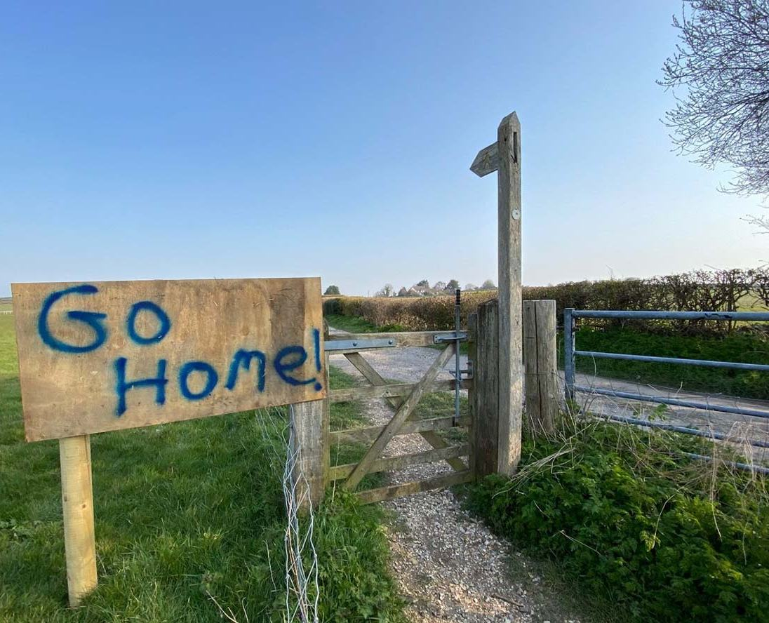One of three signs put up on public foot paths at Cokers Frome Farm during the corona virus lockdown, March 2020.