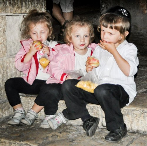 Three Orthodox Children Snacking by the Cardo, Jerusalem
