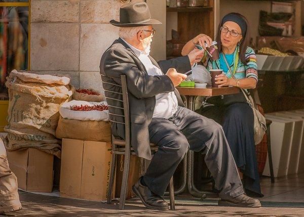 Couple on Yaffo Street enjoying coffee