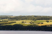 Photo of Standing Stone Vineyards from across Seneca Lake