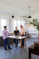 Photo of three people tasting wine in a tasting room