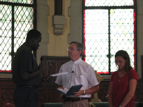 Rev. James Manyang (left) and Denise England (right) lead the Installation service of Pastor Peter on October 16, 2009.