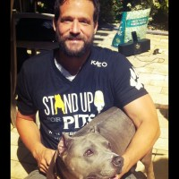 JOSH HOPKINS wearing Stand Up For PIts T-shirt
