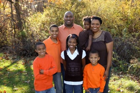 Cleveland Browns Chaplain Robert Brooks, his wife April, and their five children