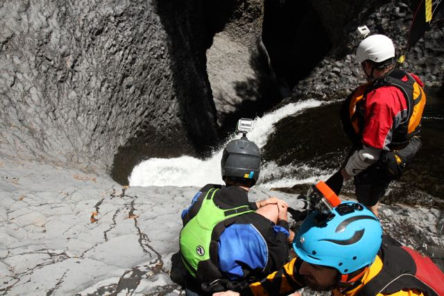 """Pucon Kayak Hostel kayakers scout the """"Throat of the Devil"""" just a kilometer upstream of the more famous Seven Teacups. Rio Claro, Chile."""