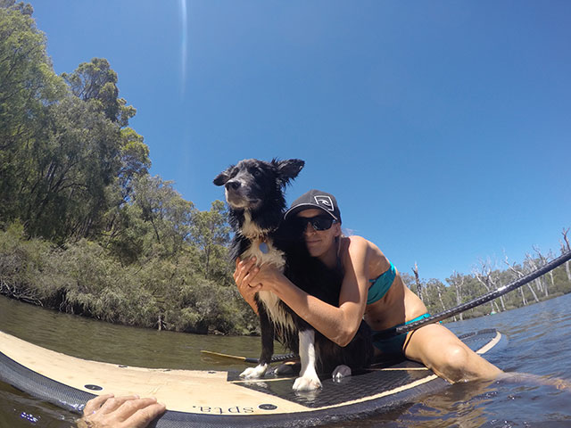 Dave Pisani: This is a photo taken of my girlfriend Kori Shinn and her crazy dog Jack. The photo was taken on a hot day in Margaret River Western Australia over the 2014 Christmas Break. It was such a hot day we decided to cool off in the river and to see if Jack would like Kori's new SUP. Kori is now hooked on the Standup paddle craze but Jack did not get the feeling and is quite happy to watch from the shore.