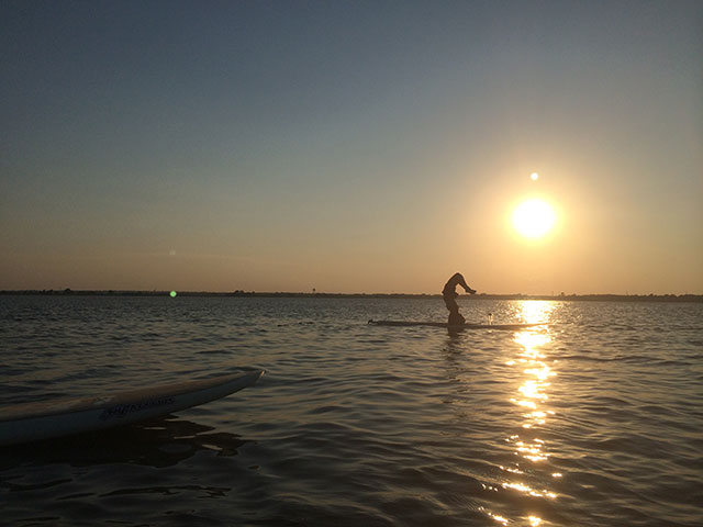 Kerry Myers: This photo was taken during our weekly SUP yoga class held at Lake Overholser in central Oklahoma during summer months.