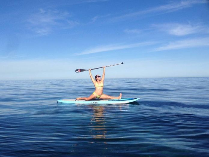 Nat Gohl: Here's Karen monkeying (aka Hunamanasana Yoga pose) on my Hobie SUP Board at Australia's best kept secret coastline - Seacliff Beach, South Austrslia. Seacliff Beach is also home to ocean SUP Yoga & Pilates classes led by Karen Leo every Sunday morning. Absolutely divine and we can't get enough :-)