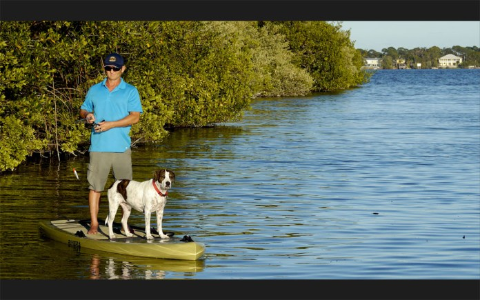 Girard Middleton of So Be Surf fishing on a Riviera Fish-On sup