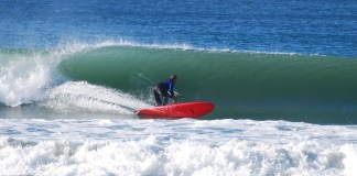Richard Harrison rips into a left-hander on his 9'8 Hanalei made by Jimmy Lewis
