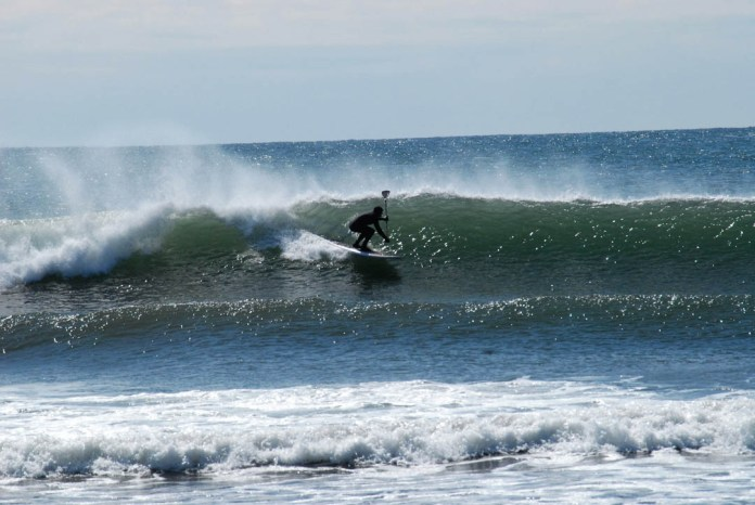 Travis Hayes Birthday Wish Maine SUP Surf wave face photo by Micky Lawler