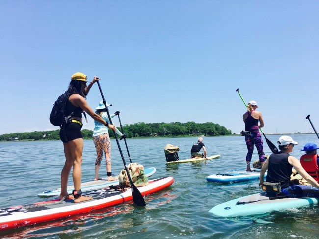 Red Paddle girls accabonac paddle and clean up
