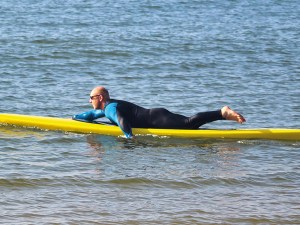 Prone paddling by Tez Plavenieks