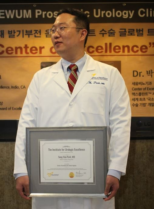 Dr. Park with his Center of Excellence Award