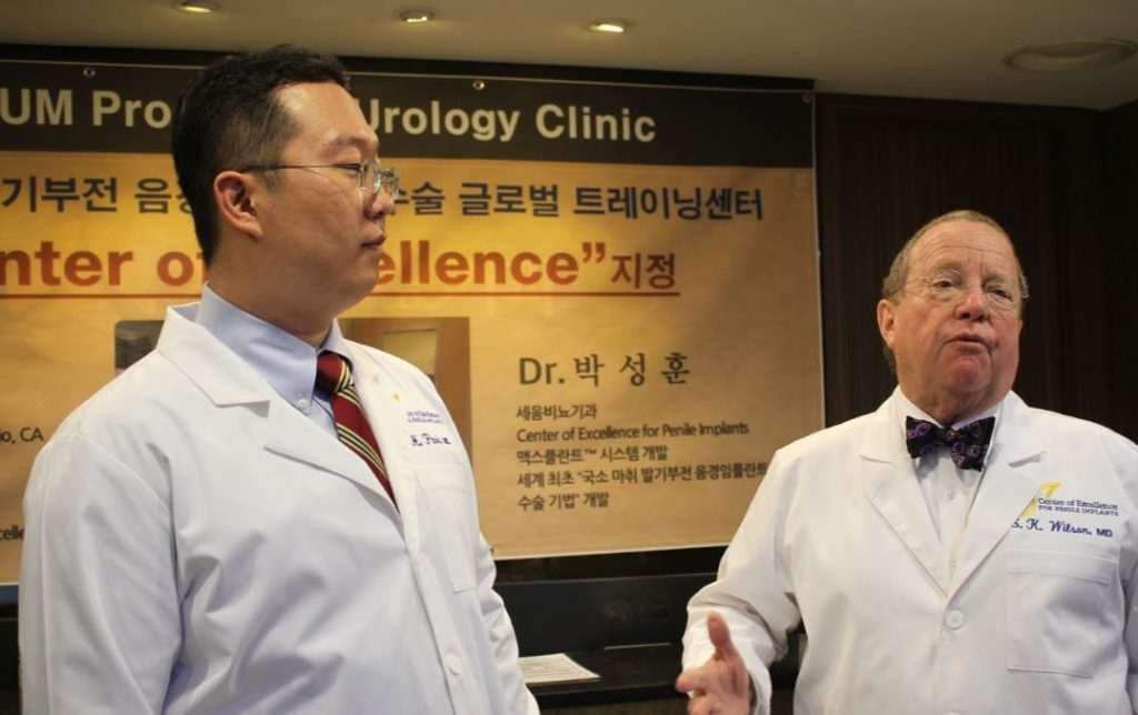 Dr. Wilson awarding Dr. Park the Center of Excellence for Penile Implants
