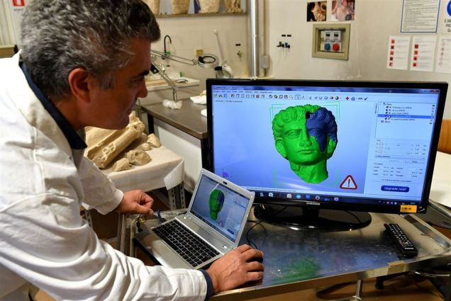 Italian restorer Antonio Iaccarino (L) shows on a computer a 3D model of the two funeral reliefs from Palmyra archeological site that will be restored at the Higher Institute of Conservation and Restoration (ISCR - Istituto Superiore per la Conservazione ed il Restauro) in Rome, on February 16, 2017. The busts of a man and a woman, dated from the 2nd and 3rd century AD and destroyed by the Islamic State group (IS), have been entrusted to the care of the technical and restorers of the ISCR in Rome. By the end of this month, they will be returned to their place of origin. Alberto PIZZOLI / AFP