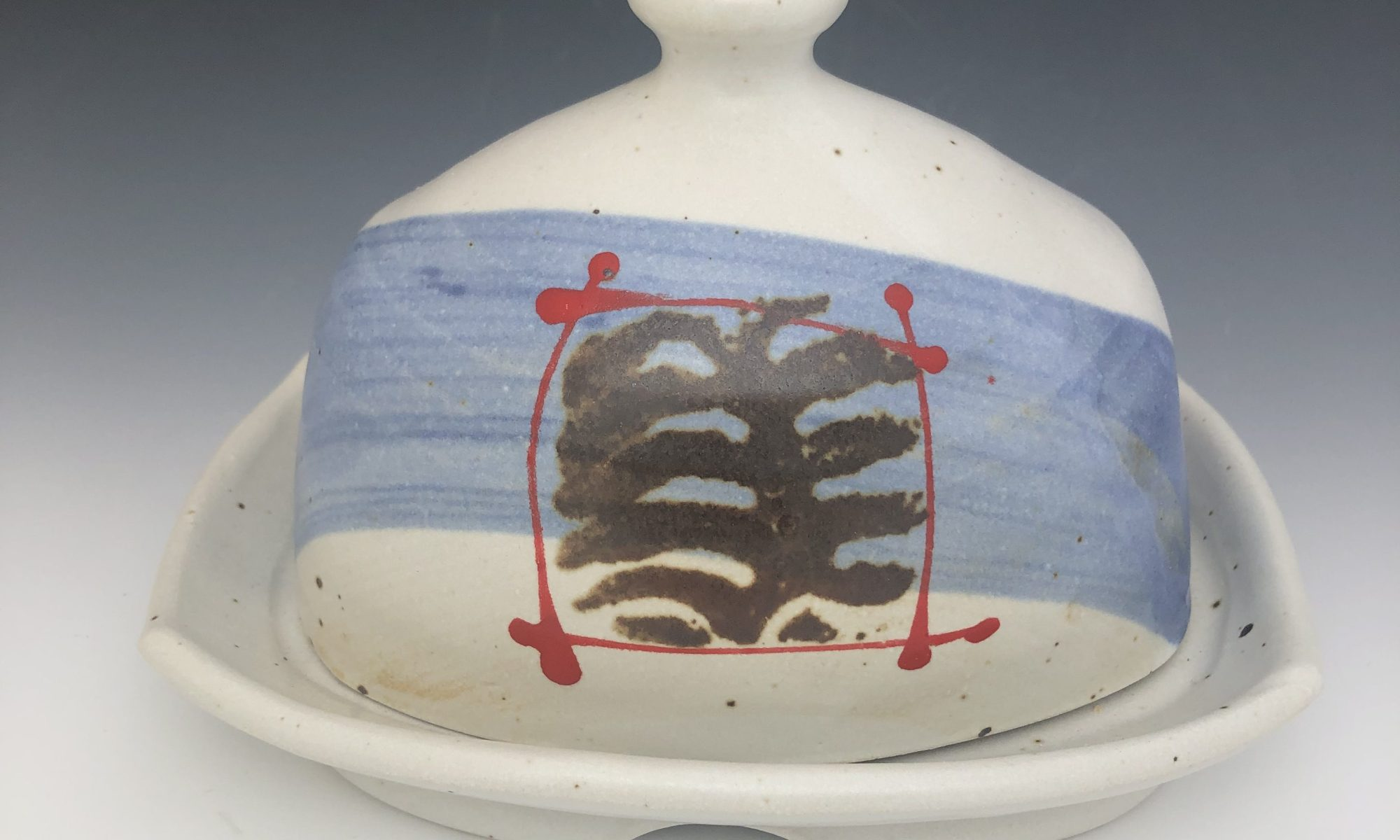 Functional butter dish created by pottery master Stan Irvin