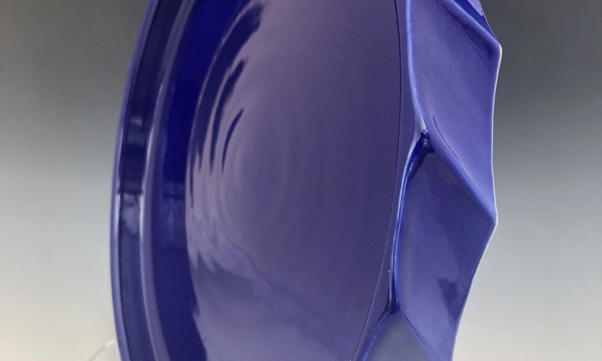 Royal blue platter created by Texan artist Stan Irvin