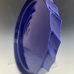 Royal blue platter created by Texan artist Stan Irvin