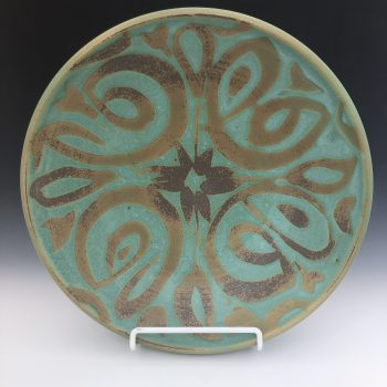 Copper and gold wheelthrown pottery created by artist Stan Irvin. Rockport Texas