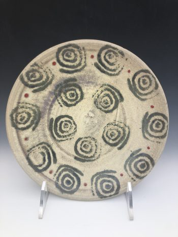 Black & Red platter wheel thrown pottery created by artist Stan Irvin.