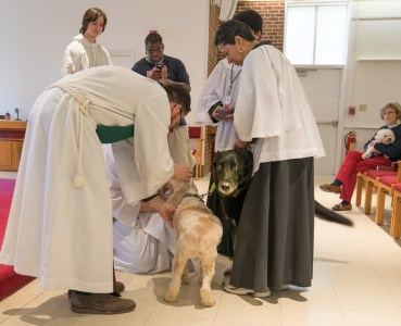 2016 Blessing of the Animals: James and Nancy bless Wendy's dogs