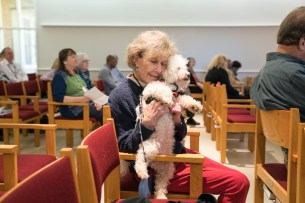 2016 Blessing of the Animals: Carol hugs her dog