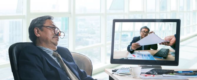 senior business man asleeping in office working time with himself working in computer monitor