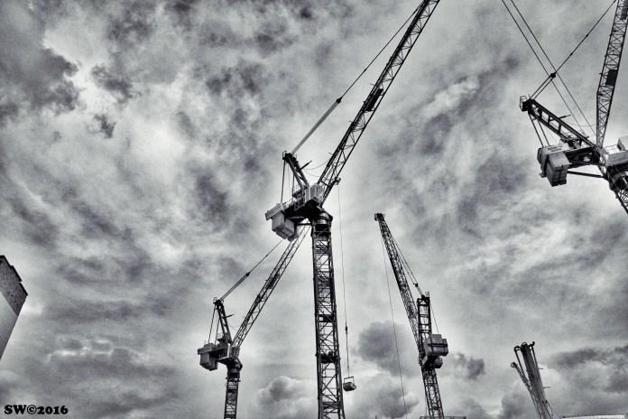 Three cranes and sky