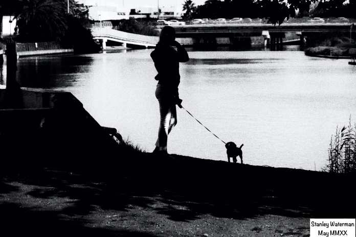 Woman with dog by the river