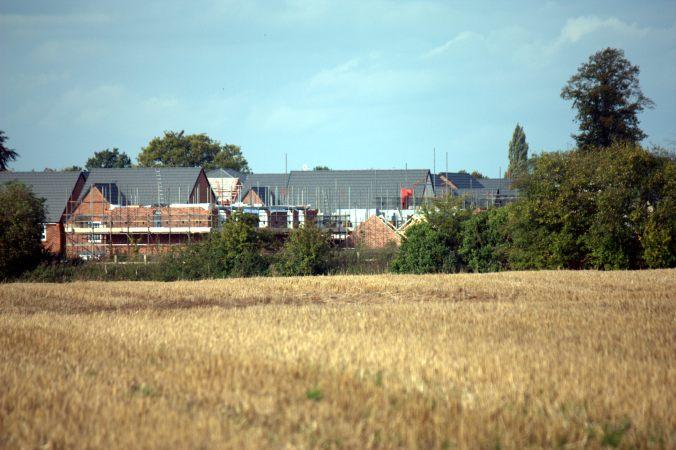 Fields in use, Stapeley Water Gardens in distance