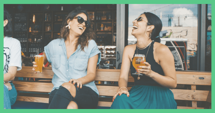 Image shows two friends laughing, drinking beer. the picture has a green border. Used on a post about how to make and save money.