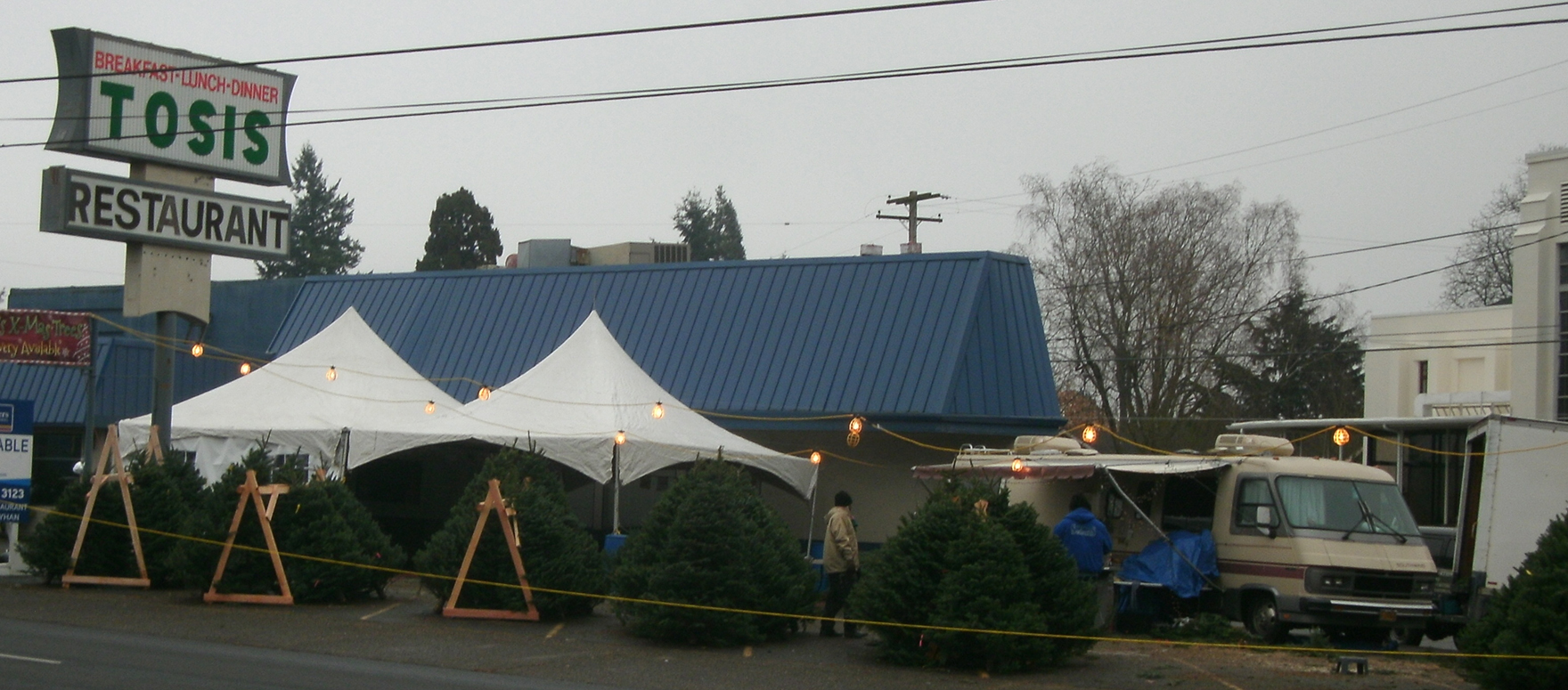 Tosis Restaurant for four decades and vacant for most of 2013, property at Northeast 62nd Avenue and Sandy Boulevard, stirred with December Christmas tree sales. (Phill Colombo)